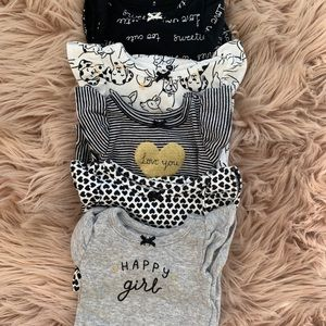 Bundle of newborn onesies
